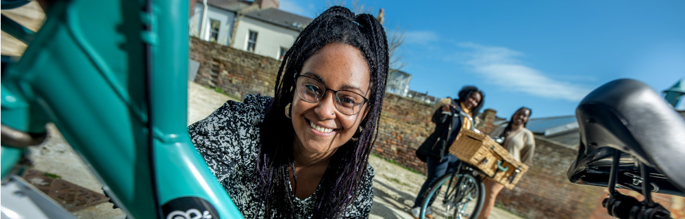 This is a picture of Nichelle Kelleher Black Butterfly, a St Leonards based charity, who received a grant from the Sussex Crisis Fund to upcycle bikes for community use