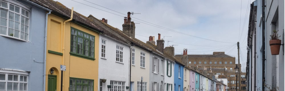 This is a picture of a row of colourful houses in Brighton
