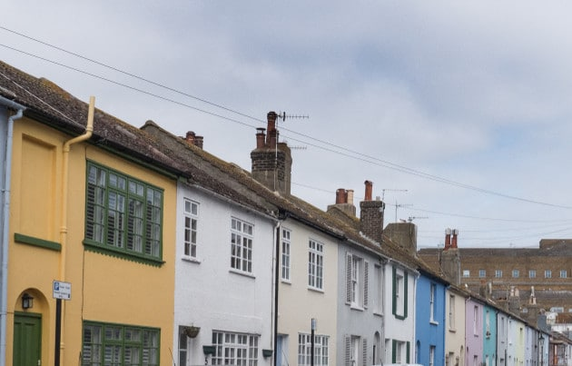 This is a picture of a colourful row of houses in Brighton