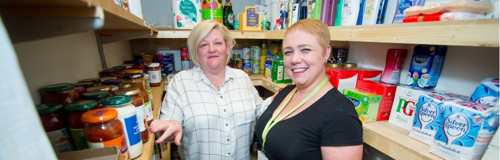 A picture of two female volunteers at the Crawley Debt Centre food bank, summer 2018