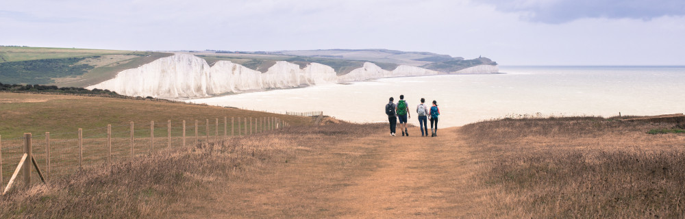 A picture of walkers at Seven Sisters