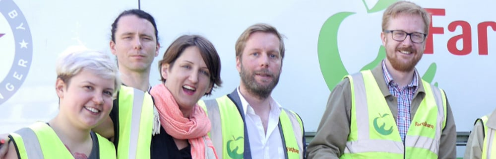This is a picture of Lloyd Russell Moyle, MP for Brighton Kemptown (right), with staff and volunteers at Fareshare Sussex
